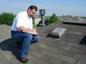 Licensed Roof Inspector in Waynesboro, Virginia taking notes on a residential roof.